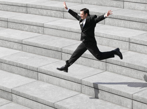 A man jumping down the stairs