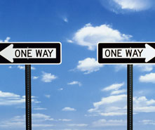 Two 'One Way' signs pointing in opposite directions.