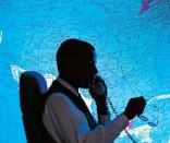 businessman sitting in front of world map