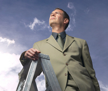 businessman standing on ladder