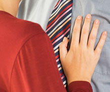 businesswoman with hand on coworkers' chest